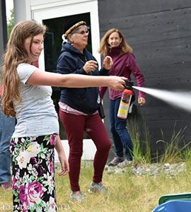 young girl with bear spray